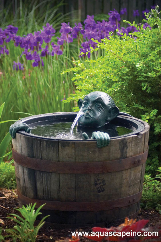 fountains in the garden, outdoor living, ponds water features, Man in a barrel adds whimsy to the garden