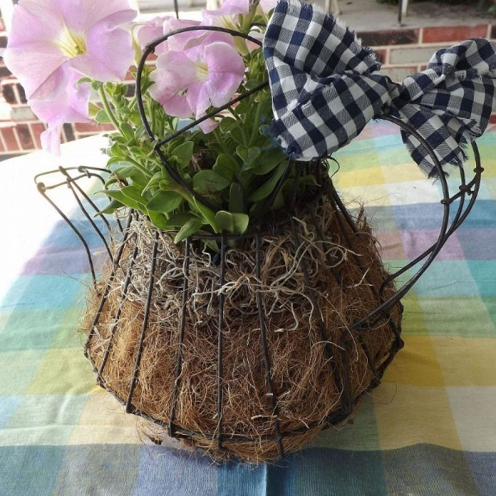 wire basket tea pot turned into a pretty plant holder, gardening, repurposing upcycling, Coconut husks are great for retaining soil in planters