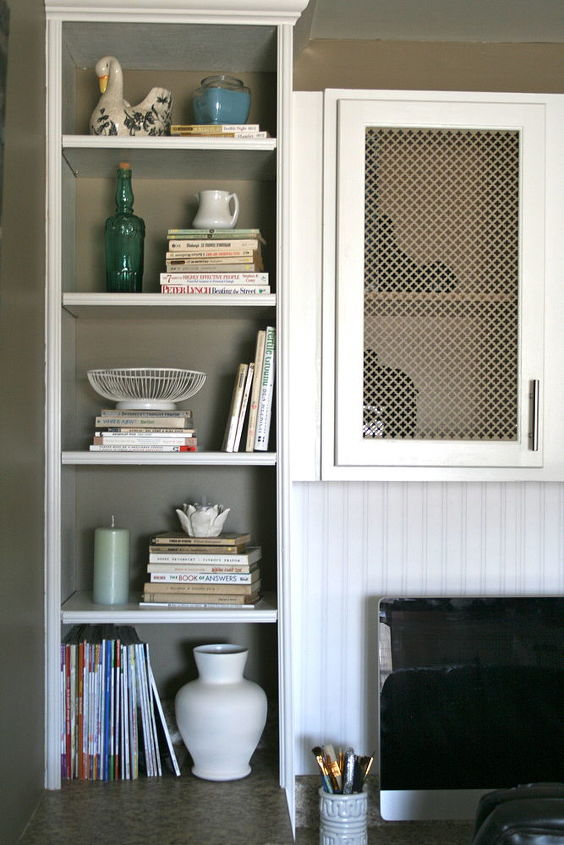 Flanking bookshelves provide even further storage options and allow for some small trinket showcases.