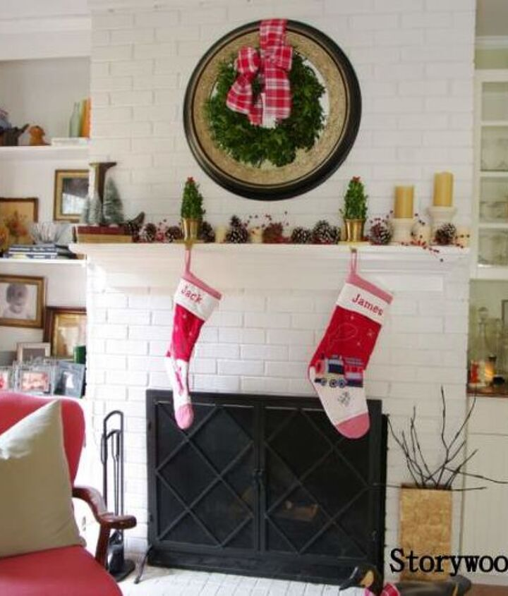 Our Family Room mantel decorated in shades of red and green.