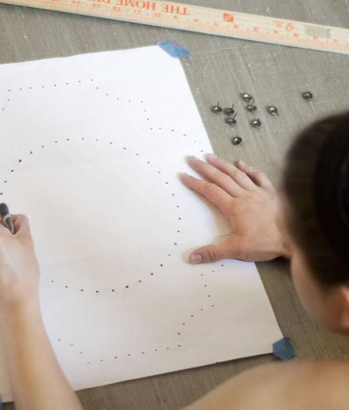 Glue wallpaper to plywood, create a design in Illustrator and print out. Poke holes in paper and mark with felt tip pen. Then hammer in all the nailheads!