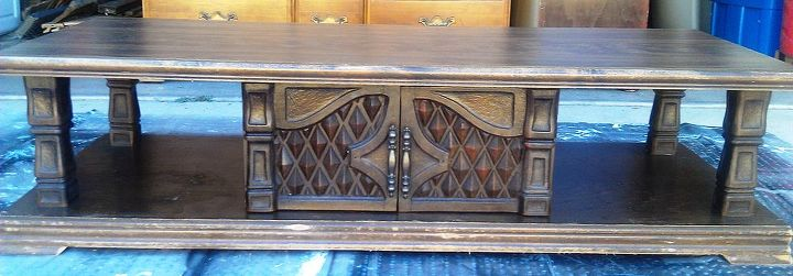 This was another free curbside old coffee table from the 80s I believe. Ugly!  It reminded me of Midieval Times. The diamond pattern on the doors gave me my inspiration.  I decided to go with a harlequin design.