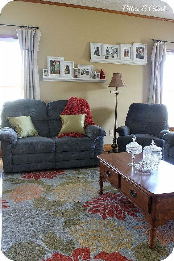 The rug, pillows, and throw help the couches blend into the room.