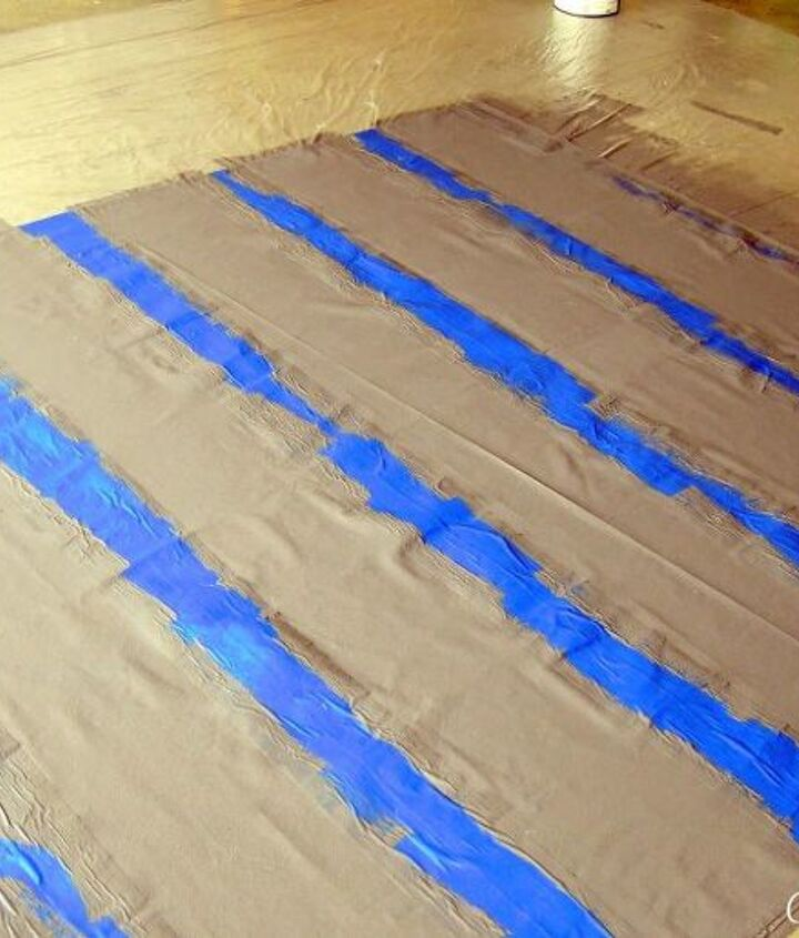 When painting fabric,t's best to go with a flat finish paint. I used Valspar's Volcanic Ash for this project and applied it with a paint roller. You'll need about 2 coats and be sure to let it dry between applications.