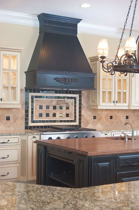 Dramatic vent hood, tile work, island & chandelier - AK