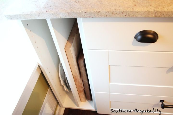 """One of the best things I did was to add this 12"""" open cabinet at the end of the run of base cabinets to house large platters and cutting board. Otherwise, it was just wasted space."""