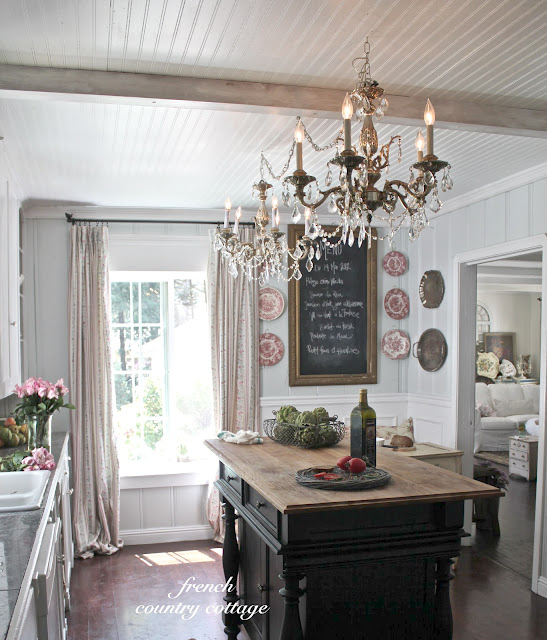 Vintage chandeliers, vintage french ticking drapes and a new but vintage inspired island.