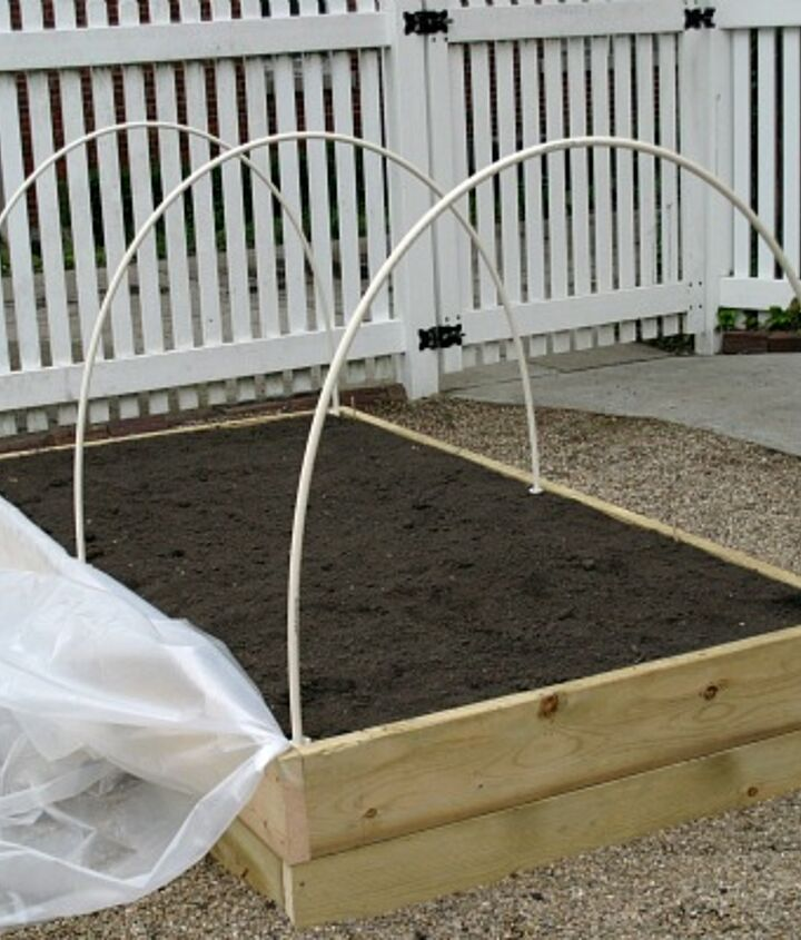 We used PVC pipe in 2 sizes, clamps and plastics sheeting.
