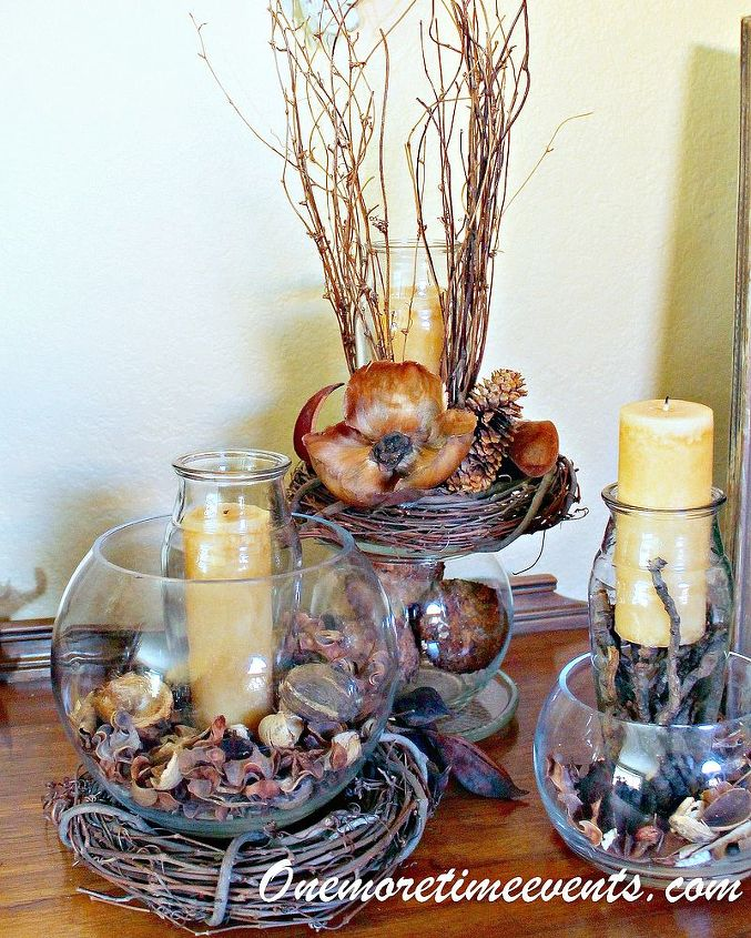 Fall Vignette using glass bowls and vases filled with candles adding natural fillers to create a fall arrangement