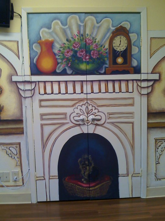 I painted a lovely fireplace with pretty decor to divert attention from the closet and TV