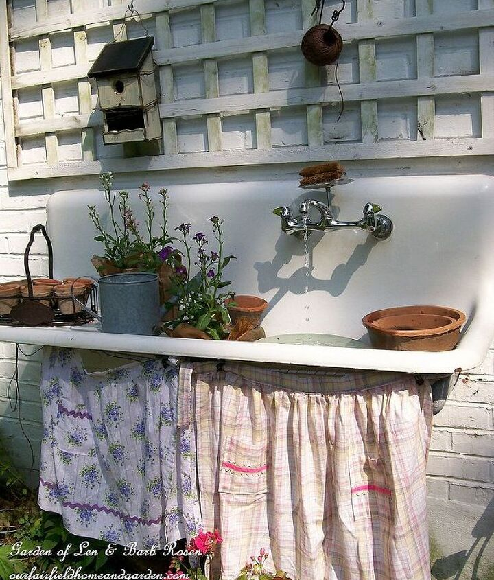 Summertime ~ aprons skirt the sink and hide the recirculating pump.