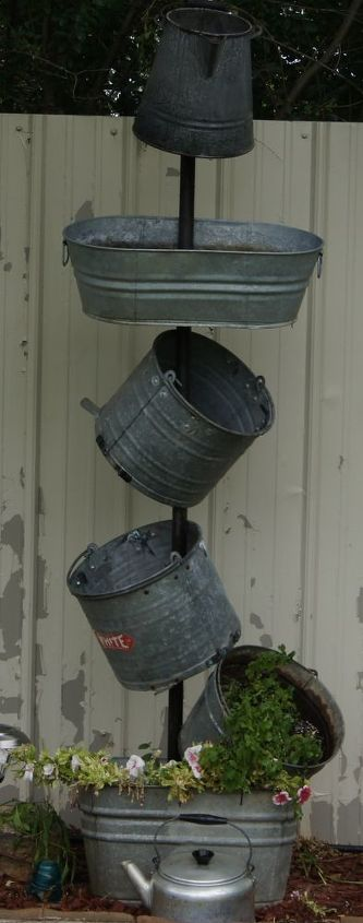 bucket planter, flowers, gardening, drill a hole in the bottom at the angle you want them to sit