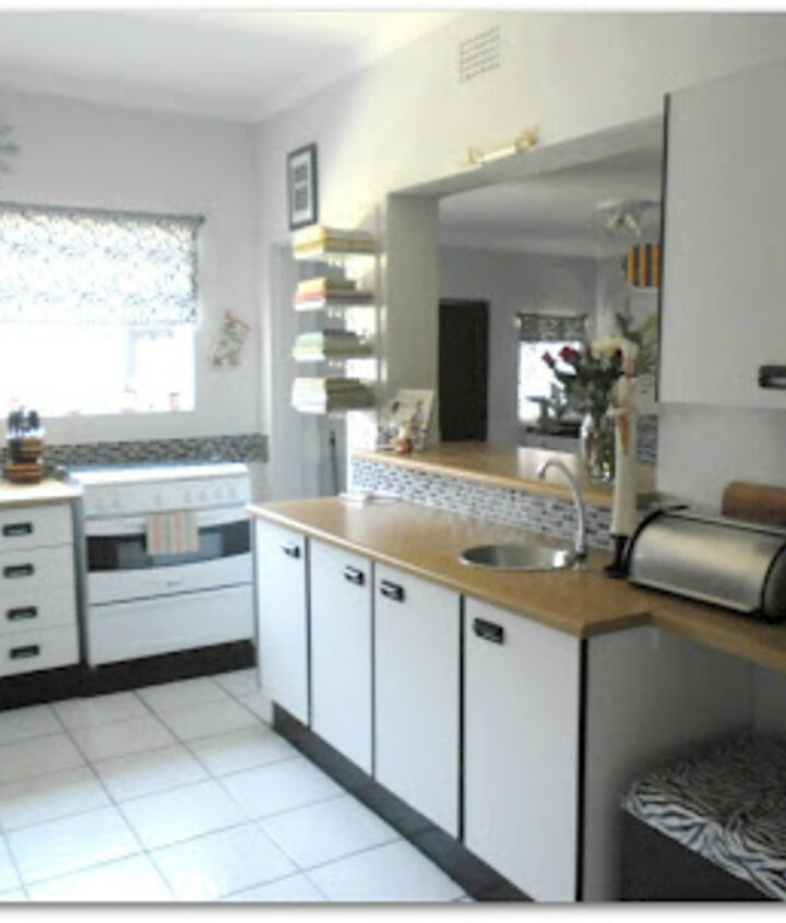 """Top counter, right, used as a dish """"drop"""" zone - scullery/laundry on the other side"""