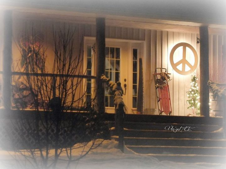 Our simple front porch, that peace sign glowed all over the property.