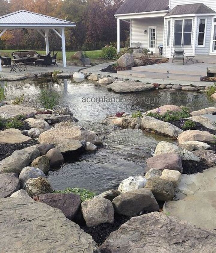 Check out this stunning oasis we recently created located at a private residence in Rush, NY Monroe County about 20 minutes from Rochester, NY. This backyard makeover included a Waterfall Pond renovation, LED Lighting, Pergola, Plants