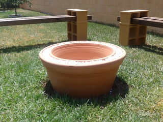 If your wanting something smaller you can uses large terra cotta pots.