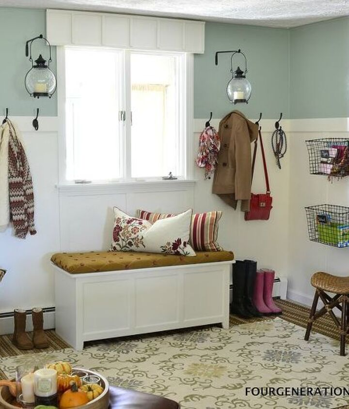 DIY a mudroom by adding a wooden wall treatment and beefy rod iron hooks with an added storage bin for shoes.