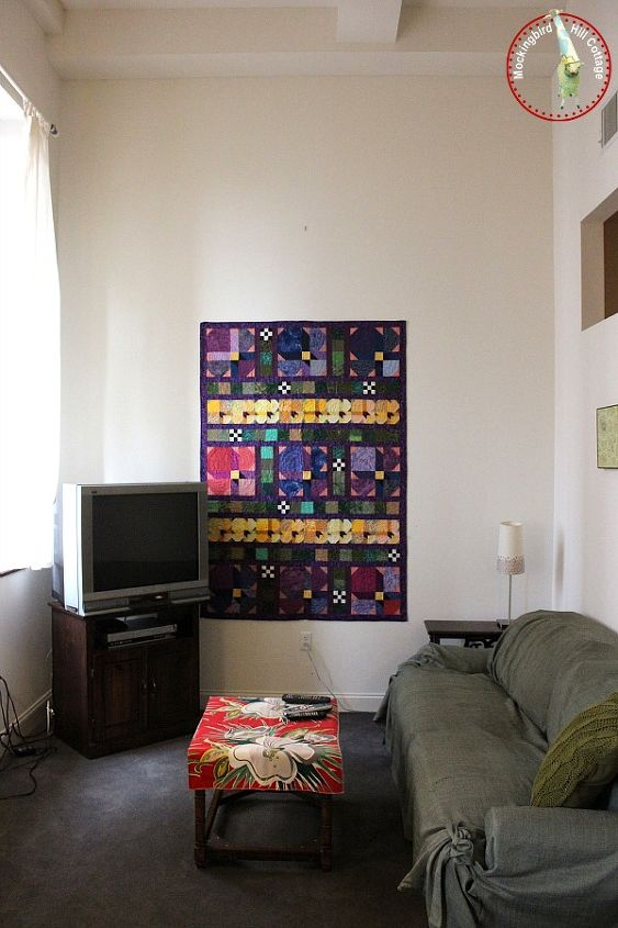 making temporary digs more like home, home decor, I hung this quilt I made on the wall with pushpins