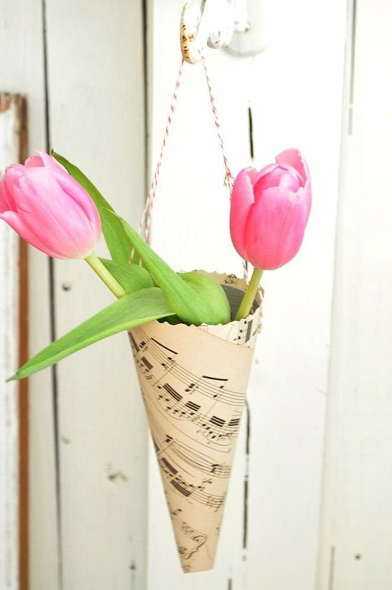 Create music sheet cones to hold tulips for a Valentine's table.