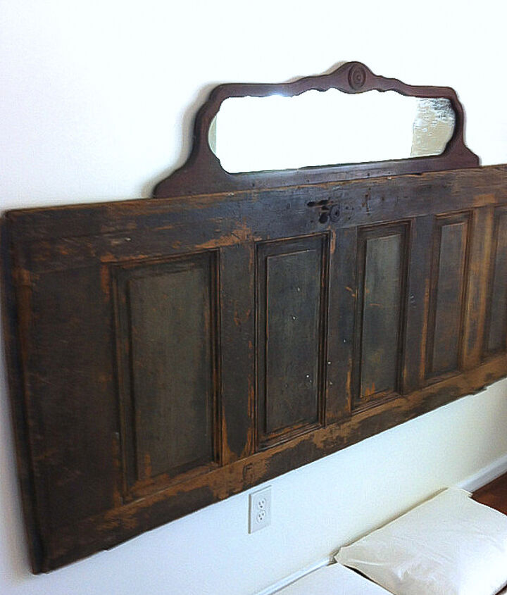 Me make a typical headboard?! Never! :) An old door topped with a vintage mirror created a romantic headboard. The patina on the door was amazing! I just scrubbed it down and protected it with a spray sealer.