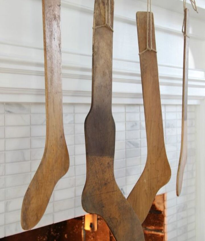 Antique stocking stretchers http://eclecticallyvintage.com/2012/11/winter-white-christmas-mantel/