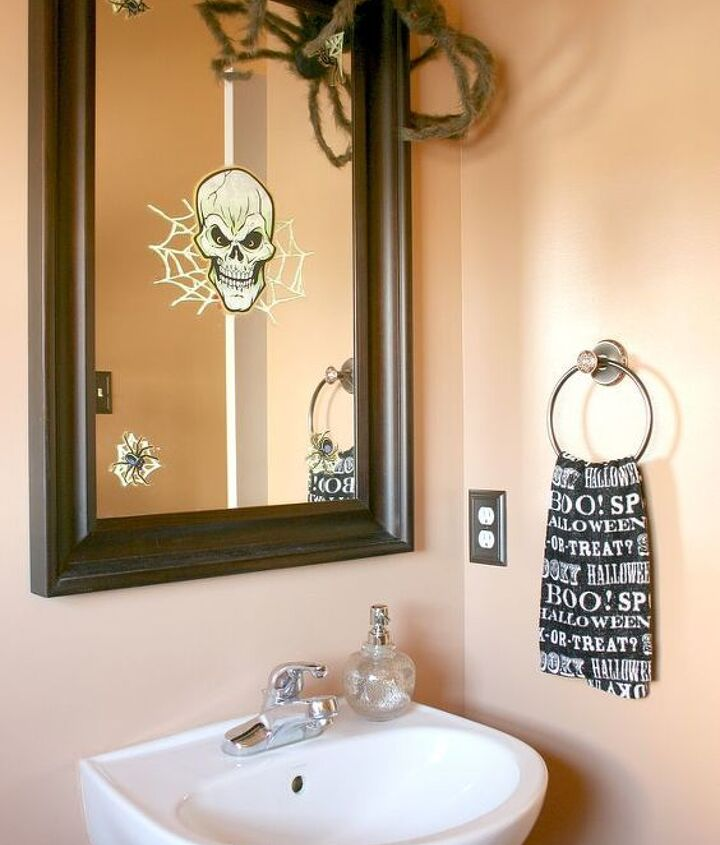 "Scary Halloween Powder Room- Kids are always complaining the decorations aren't ""scary enough"" so this room was decorated with them in mind- furry spider waiting to pounce, skeleton in the mirror & bloody handprints on the window-eek!"