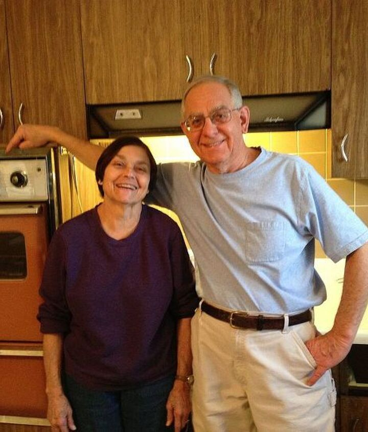Mom and Dad posing the day the kitchen demo started. Note the bungee cord which holds the oven closed.