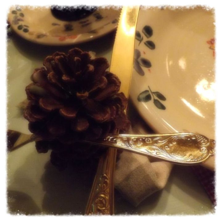 I used my favorite dishes from The Country Door , The pinecone holds the fork and knife between the slats