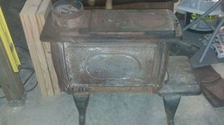 q how to restore an old cast iron wood burning stove, diy, how to, painted furniture, repurposing upcycling, Ours was missing the front door luckily this manufacturer is still in operation and was able to get us one