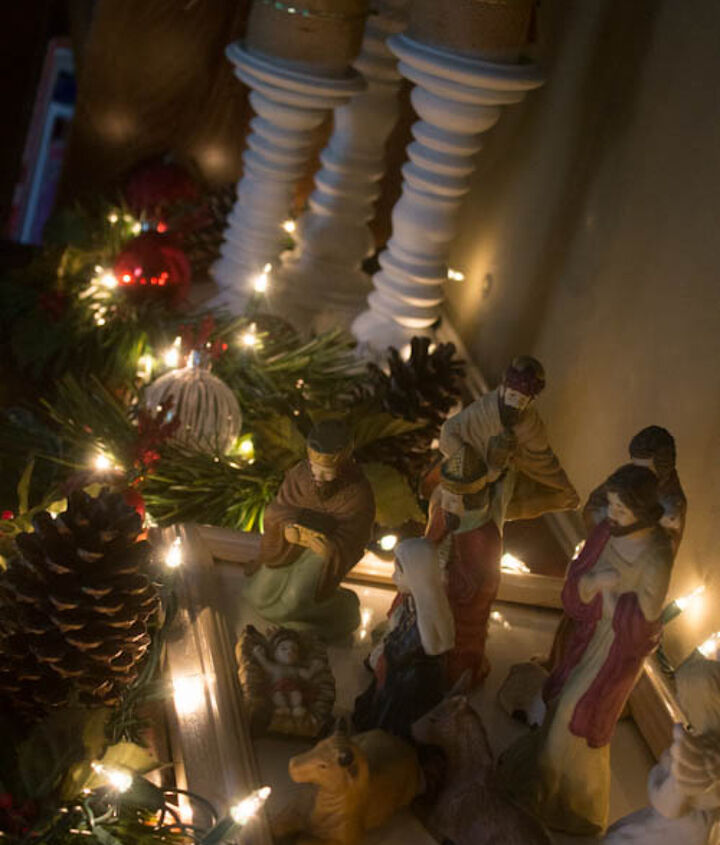 Lights and greenery accentuate the nativity