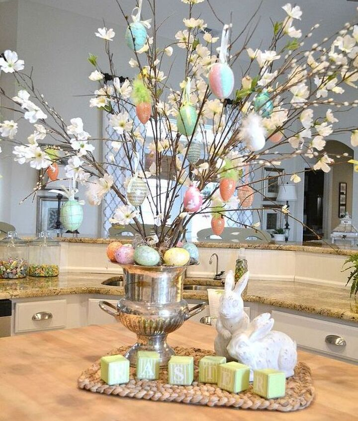 I added faux dogwood branches to our vase filled with plain branches and embellished it with Easter ornaments.