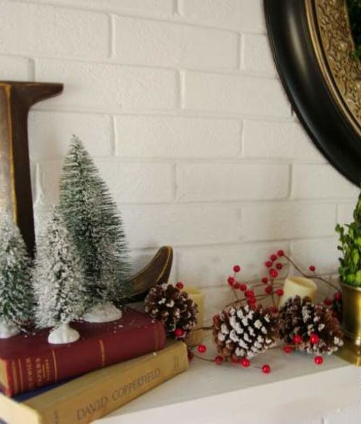 Inexpensive bottle brush trees from Walmart flank our initial and sit atop stacked books.