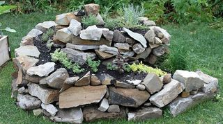 our herb spiral, gardening, landscape, One of our inspirations I photographed at the Cleveland Botanic Garden I like the tumbled look but question how it will hold up over time