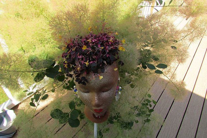 Add any kind of ground cover for the hair. Add some bling and a stake.