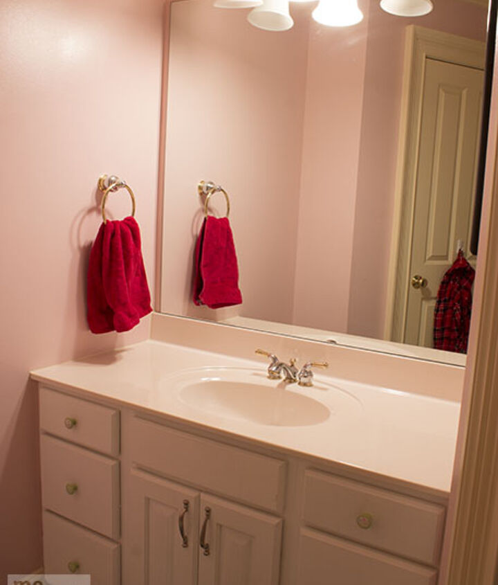 This is the before...pink walls, white cabinets, huge mirror on the wall.