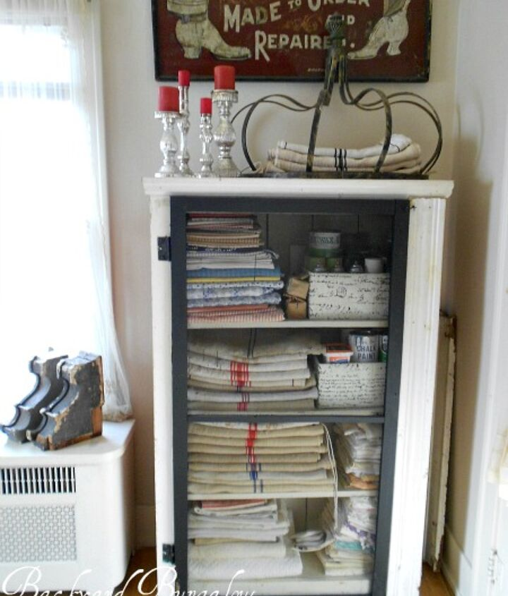 This was an old bookcase that I found and added the screen door to it. It holds my European grain sacks and collection of vintage linens