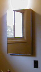 This is what the old mirror looked like --- just the 50s style mirror door. I never took a before picture but this is in the second bath which is awaiting a remodel. It is exactly the same style medicine chest I removed.