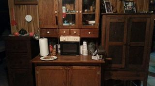 kitchen furniture, painted furniture, repurposing upcycling, An old oak hutch holds all of my appliances and large pieces and a tiny camper microwave fits perfectly in the middle space It has a pull out counter Pie safe on the Rt holds all of my dishes while a narrow cupboard sits on the Lt