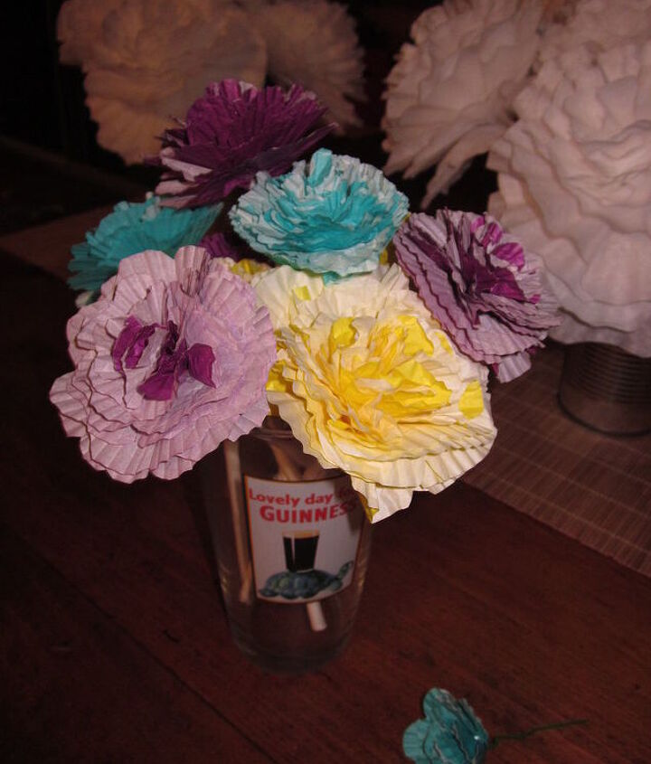 Medium cupcake liners (multicolored) wrapped around craft sticks using hot glue. Total cost $2.00