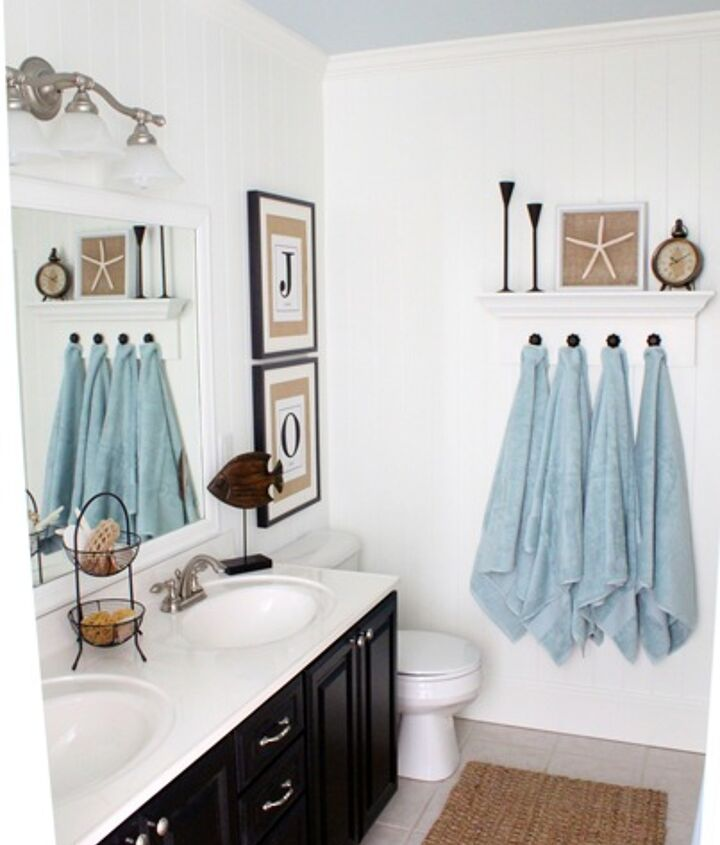 DIY coastal bathroom  http://justagirlblog.com/coastal-bathroom/