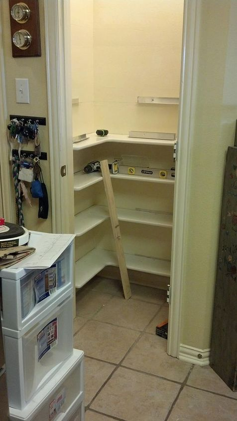 """You can see the L shaped aluminum """"brace""""  he used to hold the shelves. Smart hubby."""