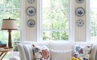 refreshed sunroom, home decor, changed the accent colors to blues reds and grays Collected accessories from antique malls ebay and Pottery Barn outlet