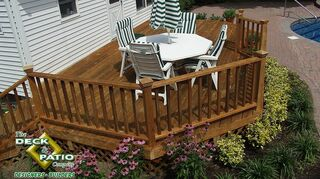 q new deck, decks, This is a cedar deck This deck has been treated with a preservative to maintain it s color and to increase it s decay resistance