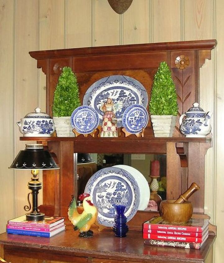 The inside of this hutch stores my cookbook collection.