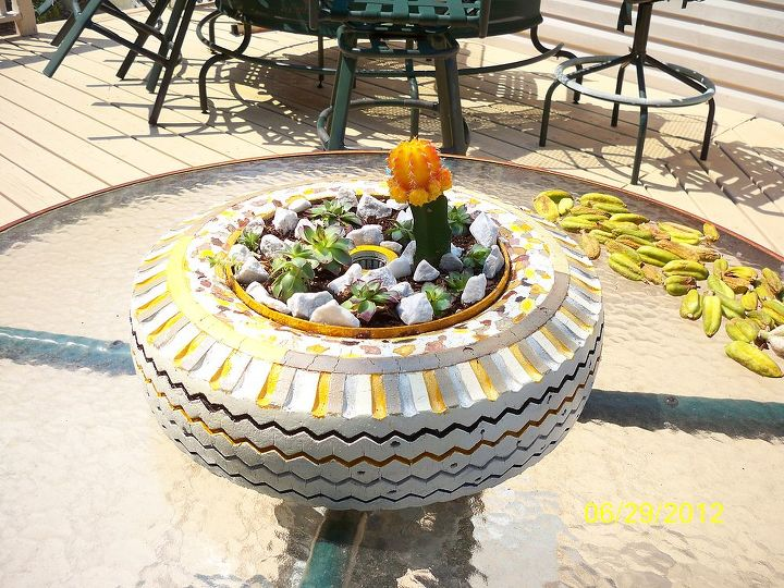 the leopart tire planter, gardening, repurposing upcycling, Perfect fit right in the middle of our never used glass table on the deck what a centerpiece