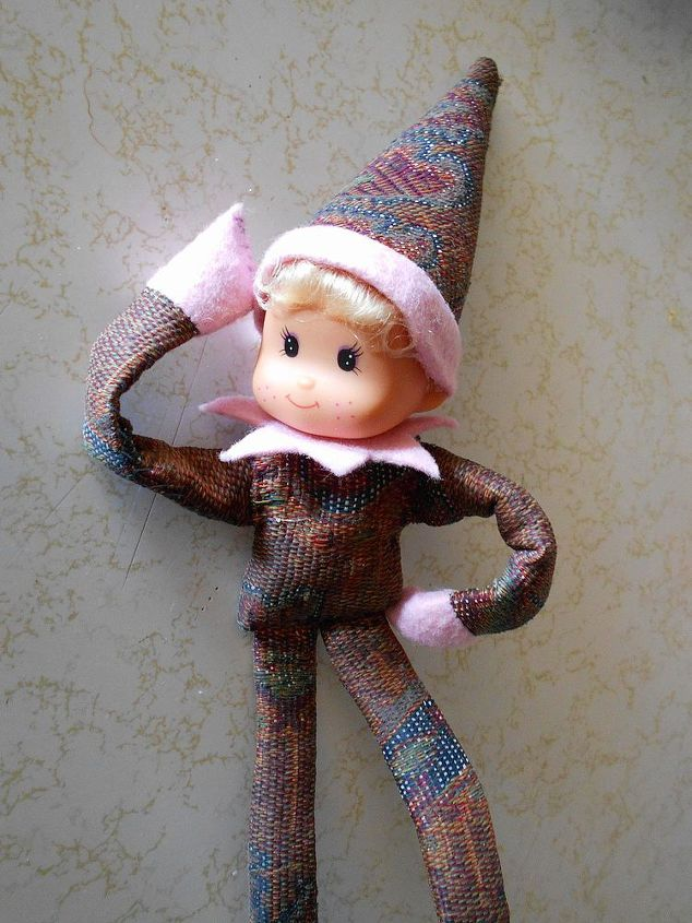 Assemble ~ dress your elf in the body suit, slip on the collar over the neck THEN snap on the head.  Top with the hat.  Now you are ready to pose!