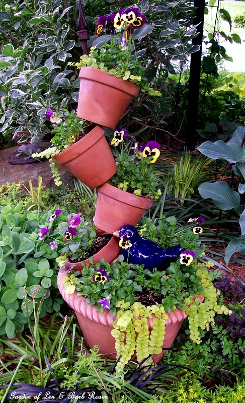 Pansies in the tipsy-pots planter how to make: http://ourfairfieldhomeandgarden.com/diy-project-build-your-own-tipsy-pots-planter/