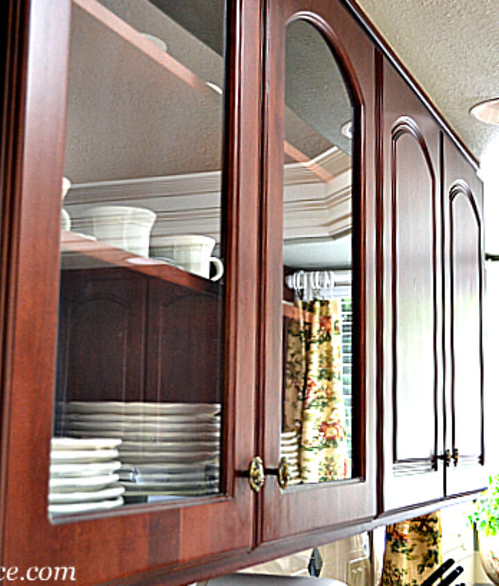 Glass front cabinets add depth and reflect light.