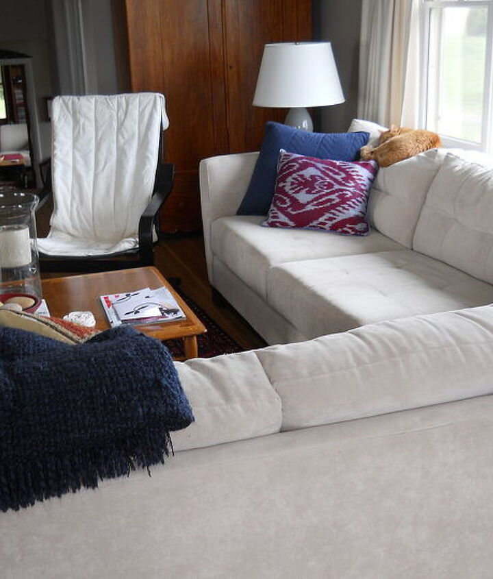 New sectional. Old IKEA chair. I love modern/eclectic. I'd love a Barcelona or a Swan chair. But color???