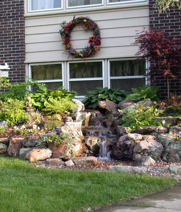 A melodic waterfall greets visitors to the entrance of this suburban home.